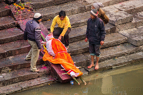hindu funeral - corpse of the dead washed before cremation (nepal), bagmati river, cadaver, corpse, dead, festival, funeral, ghats, hinduism, kathmandu, lying in wake, maha shivaratri, pashupati, pashupatinath, shroud, steps, washed, washing, water