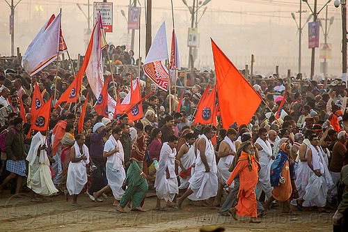 hindu guru and and his ashram members running toward the sangam for holy bath - kumbh mela (india), crowd, dawn, flags, hindu pilgrimage, hinduism, india, kumbh maha snan, maha kumbh mela, mauni amavasya, running, triveni sangam, walking