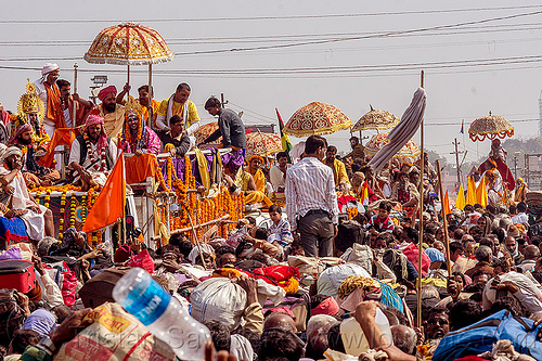 hindu guru parade - massive traffic jam in crowded street - kumbh mela (india), crowd, float, gurus, hindu pilgrimage, hinduism, india, kumbh maha snan, maha kumbh mela, mauni amavasya, parade, umbrellas