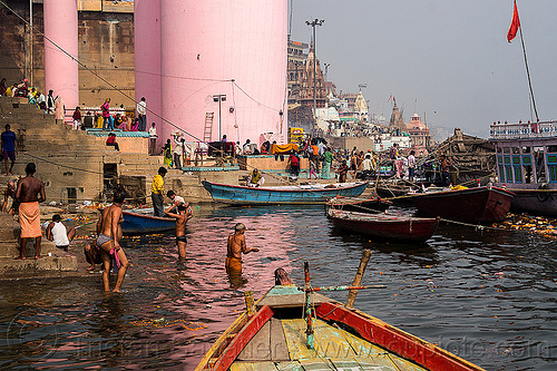 hindu holy bath in the ganges river - ghats of varanasi (india), bathing, boats, ganga, ganga river, hinduism, holy dip, mooring, people, pink, pink tower, river bath, river bathing, river boats, water, water tower
