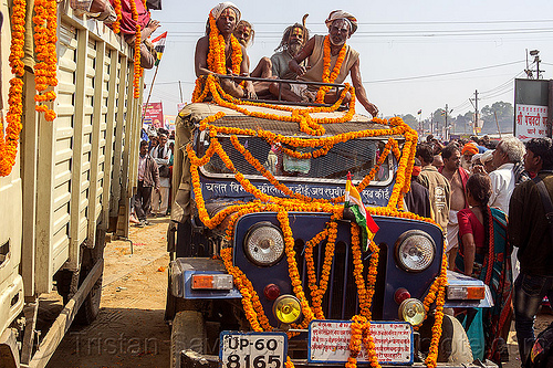hindu holy men on top of decorated jeep - kumbh mela (india), beard, car, crowd, float, gurus, hinduism, kumba mela, kumbh maha snan, kumbha mela, maha kumbh mela, mauni amavasya, parade, people