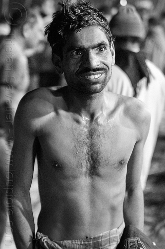 hindu man after holy bath in ganges river (india), bare chest, black eyes, hindu pilgrimage, hinduism, india, maha kumbh mela, man, paush purnima, pilgrim, shiny eyes, triveni sangam