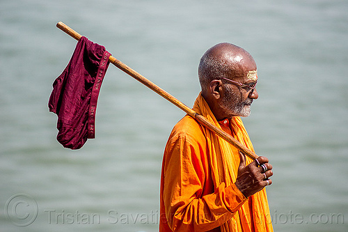 hindu man drying underpants on stick - varanasi (india), baba, bhagwa, cane, drying, finger rings, ganga, ganges river, hindu, hinduism, india, man, purple, saffron color, tilak, underpants, underware, varanasi