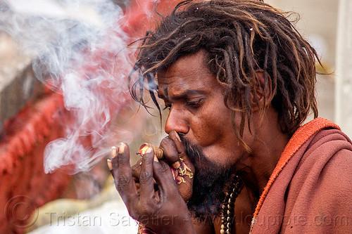 hindu man smoking ritual cannabis (nepal), baba, bhang, chillum, dreads, festival, hinduism, kathmandu, maha shivaratri, marijuana, pashupati, pashupatinath, people, sadhu, smoke