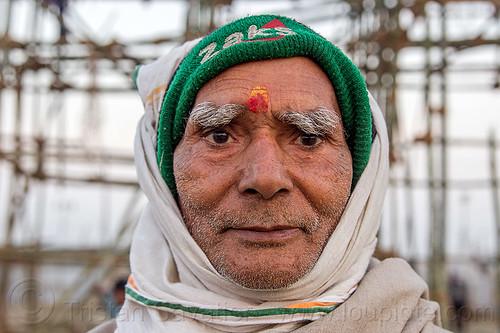 hindu man with bushy eyebrows, bushy eyebrows, green, headress, headwear, hindu, hinduism, knitcap, kumbha mela, maha kumbh mela, old man, tilak, tilaka, unshaven