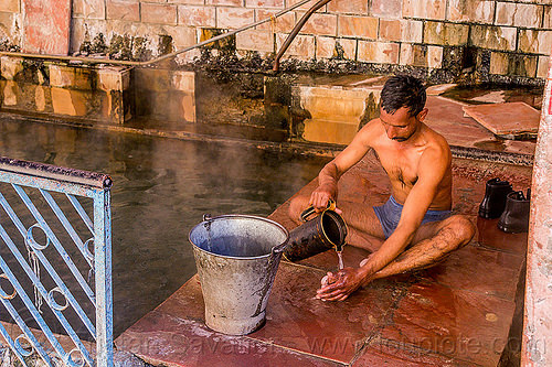 hindu pilgrim bathing at the surya kund pool - yamunotri sacred hot springs (india), bath, bucket, men, metal bucket, people, sitting, water