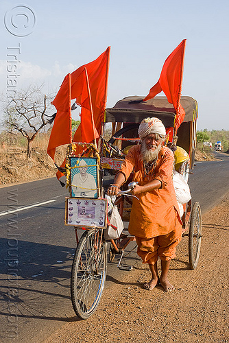 hindu pilgrim on cycle rickshaw (india), amarnath yatra, bare feet, barefoot, bhagwa, cycle rickshaw, hindu pilgrimage, india, old man, pilgrim, red flags, road, saffron color, trike