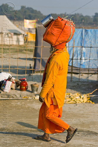hindu pilgrim walking with bag on head (india), bag, carrying on the head, hindu, hinduism, kumbha mela, luggage, maha kumbh mela, man, orange color, pilgrim, walking, yatri