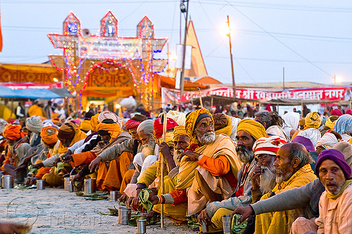 hindu pilgrims eating holy prasad - kumbh mela 2013 (india), ashram, crowd, dinner, eating, food, hindu, hinduism, holy prasad, kumbha mela, maha kumbh mela, men, pilgrims, rows, sitting, yatris