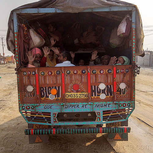 hindu pilgrims in back of truck - kumbh mela (india), exodus, hands, hindu pilgrimage, hinduism, india, lorry, maha kumbh mela, truck