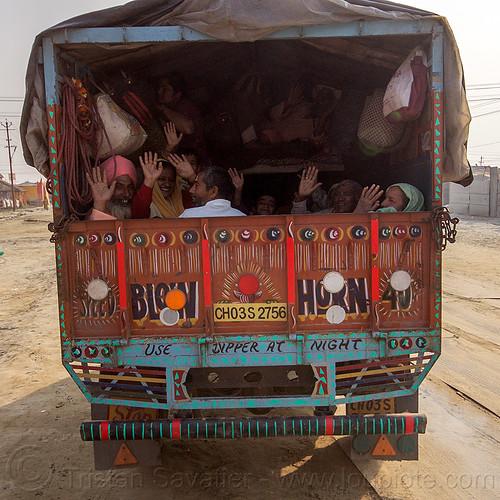 hindu pilgrims in back of truck - kumbh mela (india), exodus, hands, hindu, hinduism, kumbha mela, lorry, maha kumbh mela, truck