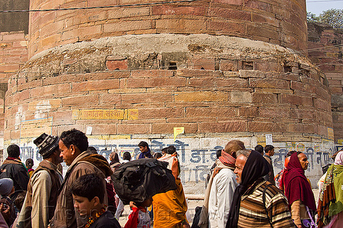 hindu pilgrims near base of tower of allahabad fort - kumbh mela 2013, allahabad fort, defensive wall, fortifications, fortress, hindu, hinduism, kumbha mela, maha kumbh mela, masonry, men, paush purnima, pilgrims, rampart, stone, tower, walking, yatris