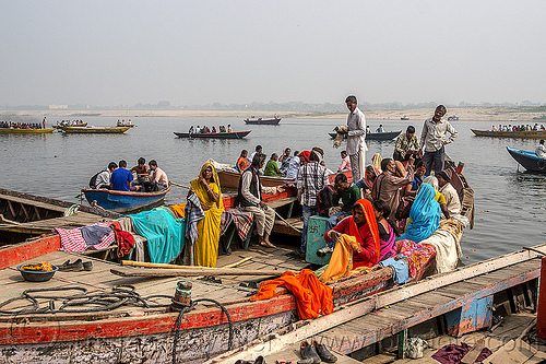 hindu pilgrims on river boats - varanasi (india), ganga, ganges river, ghats, hindu, hinduism, india, men, river boats, sarees, saris, sitting, standing, varanasi, women