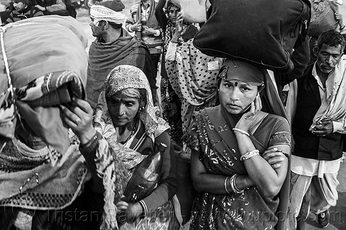 hindu pilgrims on their way home after kumbh mela (india), bags, bundles, carrying on the head, exodus, hindu, hinduism, kumbha mela, luggage, maha kumbh mela, men, night, street, walking, women