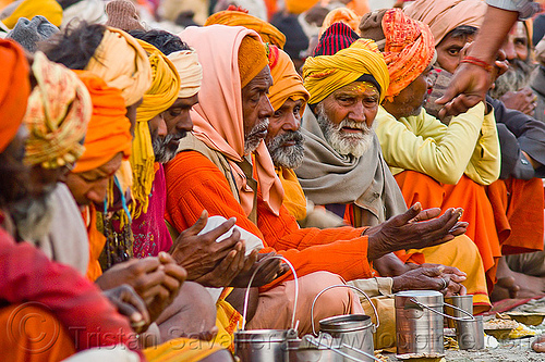 hindu pilgrims receiving holy prasad - kumbh mela 2013 (india), ashram, bhagwa, crowd, dinner, eating, food, hindu pilgrimage, hinduism, holy prasad, india, maha kumbh mela, men, pilgrims, rows, saffron color, sitting