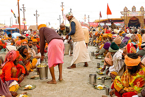 hindu pilgrims receiving holy prasad - kumbh mela 2013 (india), ashram, buckets, crowd, dinner, eating, food, hindu, hinduism, holy prasad, kumbha mela, maha kumbh mela, men, pilgrims, rows, serving, sitting, yatris