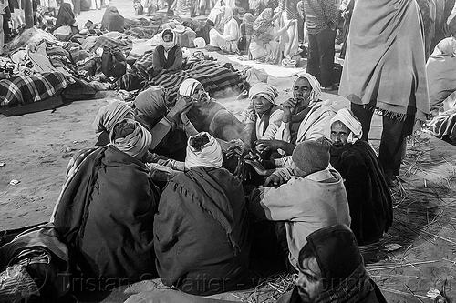 hindu pilgrims sitting in circle at kumbh mela (india), camping, crowd, hindu, hinduism, kumbh maha snan, kumbha mela, maha kumbh mela, mauni amavasya, men, night, sitting, sleeping, smoking, street, triveni sangam, walking