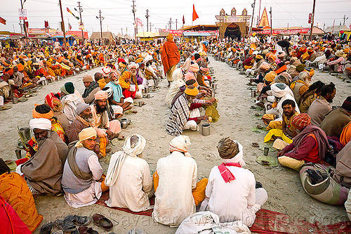 hindu pilgrims sitting in rows, waiting for holy prasad - kumbh mela 2013 (india), ashram, crowd, eating, food, hindu pilgrimage, hinduism, holy prasad, india, maha kumbh mela, men, pilgrims, rows, sitting