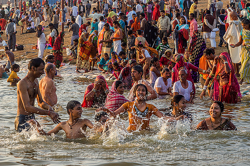 hindu pilgrims taking holy dip in ganges river (india), crowd, ganga, ganges river, hindu pilgrimage, hinduism, holy bath, holy dip, india, maha kumbh mela, nadi bath, river bank, river bathing, splash, splashing, triveni sangam