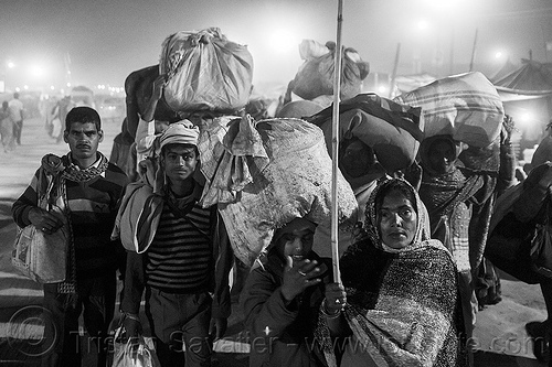hindu pilgrims travelling back home after the kumbh mela (india), bags, bundles, carrying on the head, crowd, exodus, hindu pilgrimage, hinduism, india, luggage, maha kumbh mela, men, night, walking, women