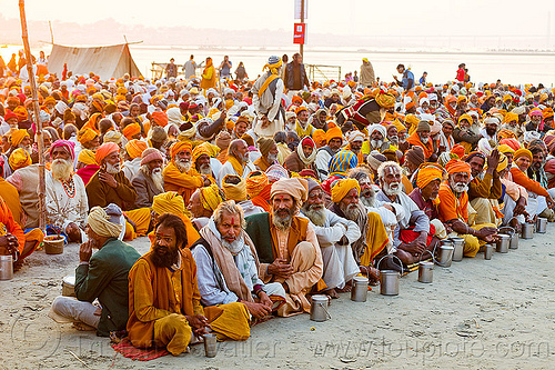 hindu pilgrims waiting for holy prasad - kumbh mela 2013 (india), ashram, crowd, dinner, eating, food, hindu pilgrimage, hinduism, holy prasad, india, maha kumbh mela, men, pilgrims, rows, sitting