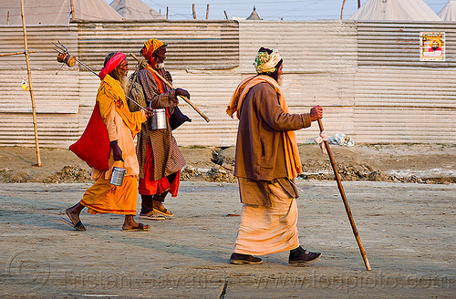 hindu pilgrims walking - kumbh mela 2013 (india), baba, bhagwa, cane, food boxes, hindu holy man, hindu pilgrimage, hinduism, india, maha kumbh mela, men, pilgrims, sadhu, saffron color, sticks, walking stick