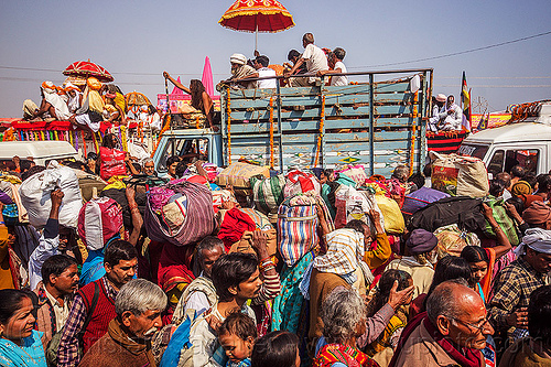 hindu pilgrims with bags in crowded street - kumbh mela (india), bags, bundles, crowd, exodus, float, gurus, hindu pilgrimage, hinduism, india, kumbh maha snan, lorry, luggage, maha kumbh mela, mauni amavasya, parade, truck, umbrella