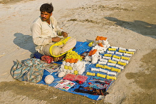 hindu sacred threads (ritual ropes) - india, hindu pilgrimage, hinduism, india, maha kumbh mela, man, ritual ropes, rope bundles, sacred thread, sitting, stall, street market, street seller, street vendor, yajno pavitam