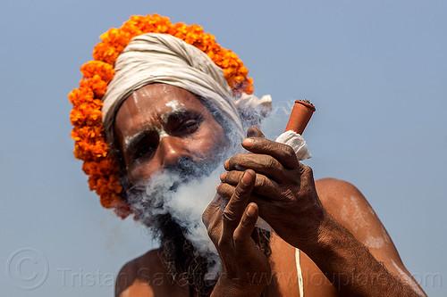 hindu sadhu smoking ritual ganja with chillum (india), baba, cannabis, chillum, headdress, headwear, hindu, hinduism, kumbh maha snan, kumbha mela, maha kumbh mela, man, marijuana, mauni amavasya, sadhu, smoke, smoking