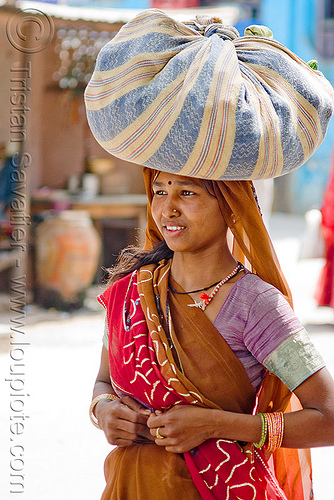 hindu woman carrying bag on head - sailana (india), bag, carrying on the head, india, sailana, saree, sari, woman