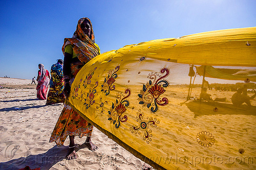 hindu woman drying sari in the wind - varanasi (india), beach, drying, india, sand, saree, sari, varanasi, wind, woman, yellow