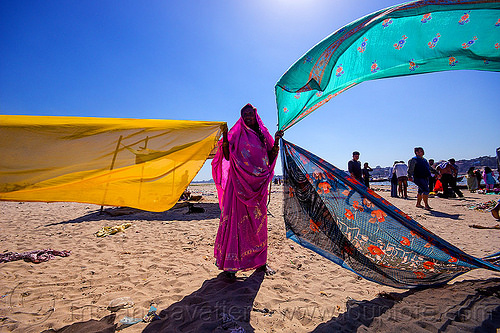 hindu woman drying saris in the wind after holy bath in the ganges river - varanasi (india), beach, drying, india, river bank, sand, saree, sari, varanasi, wind, woman