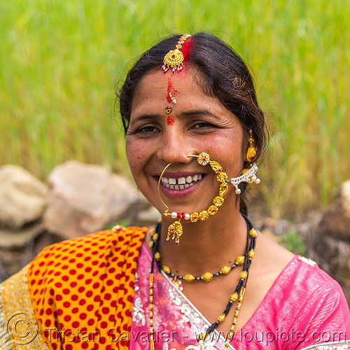 woman with large nose ring jewelry (india), bindis, bride, indian wedding, jewelry, necklaces, nose chain, nose piercing, nose ring, nostril piercing, tilak, tilaka, tola gunth, woman