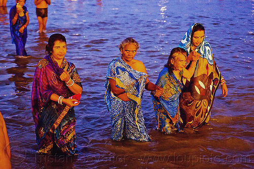 hindu women bathing in the ganges river at dawn, dawn, ganga, ganges river, hindu pilgrimage, hinduism, holy bath, holy dip, india, maha kumbh mela, men, nadi bath, old woman, paush purnima, pilgrims, ritual bath, river bathing, saree, triveni sangam, women