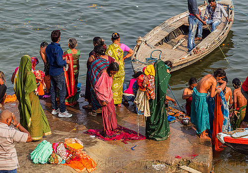 hindu women bathing in the ganges river in varanasi (india), ganga, ganges river, ghats, holy bath, holy dip, india, nadi bath, river bathing, river boat, sarees, saris, varanasi, women