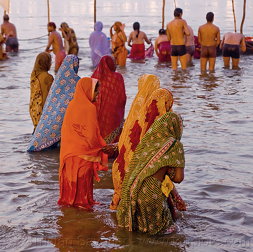 hindu women bating  in the ganges river at sangam - kumbh mela 2013 (india), dawn, ganga river, ganges river, hindu, hinduism, holy bath, holy dip, kumbha mela, maha kumbh mela, men, paush purnima, pilgrims, ritual bath, river bath, river bathing, saree, triveni sangam, water, women, yatris