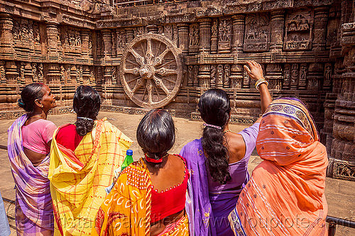 hindu women looking at ancient erotic stone carvings - sculpture - konark sun temple (india), erotic sculptures, high-relief, hindu temple, hinduism, india, konark sun temple, maithuna, sarees, saris, stone wheel, women