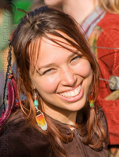 hippie girl with feathers, feather earrings, feather hair extensions, feathers, haight st, haight street fair, hippie, woman