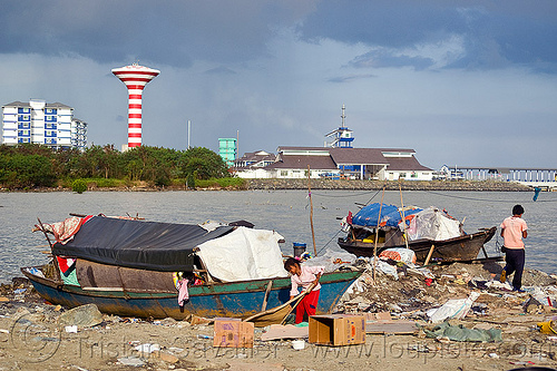 homeless living on boats, encampment, garbage, homeless camp, lahad datu, ocean, poor, rubbish, sea, seashore, shore, small boats, trash, wasteland, water tower