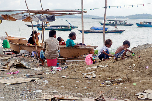 homeless living on boats, borneo, chid, children, encampment, garbage, homeless camp, kids, lahad datu, malaysia, poor, seashore, small boats, trash, wasteland