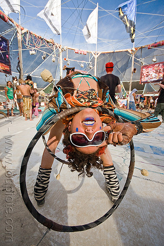 hooper bending backward - burning man 2010, ahni radvanyi, bending backward, burning man, hula hoop, hula hooper, hula hooping, mini hoops, sunglasses, woman