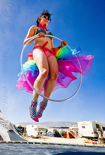 hooper on trampoline - burning man 2012, burning man, campoline, hula hoop, jump shot, rainbow colors, socks, trampolin, tutu, woman