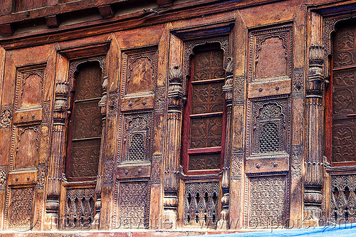 house facade with intricate wood carvings in almora (india), almora, carved, facade, house, india, intricate, low relief, windows, wood carving, wooden