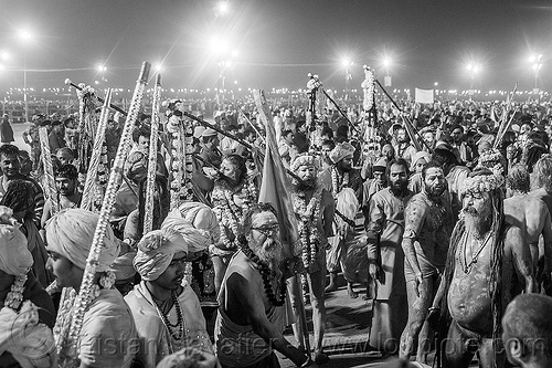 huge crowd of hindu devotees gathers before dawn near the ganges - kumbh mela 2013 (india), crowd, dawn, flower necklaces, hindu pilgrimage, hinduism, holy ash, india, maha kumbh mela, marigold flowers, men, naga babas, naga sadhus, night, sacred ash, sadhu, triveni sangam, vasant panchami snan, vibhuti, walking