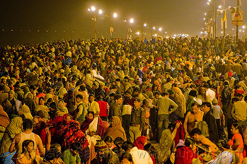 huge crowd of hindu pilgrims near sangam - kumbh mela 2013, crowd, hindu pilgrimage, hinduism, india, maha kumbh mela, men, night, paush purnima, pilgrims, street lights, triveni sangam, women