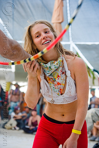 hula hooper at the center camp cafe - ashley - burning man 2009, arm, ashley, burning man, hoop passing, hula hoop, hula hooper, hula hooping, passing hoop, woman