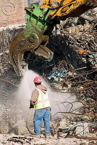 hydraulic crusher jaws - worker - building demolition, at work, attachment, building demolition, caterpillar, crusher jaws, heavy equipment, hydraulic crusher, machinery, presidio hospital, presidio landmark apartments, spraying water, water spray, working
