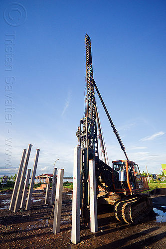 hydraulic pile driver - concrete foundation piles, at work, beluran, borneo, building construction, building foundations, columns, foundation works, groundwork construction, hydraulic hammer, malaysia, pile driver, pile driving, precast concrete piles, reinforced concrete, working