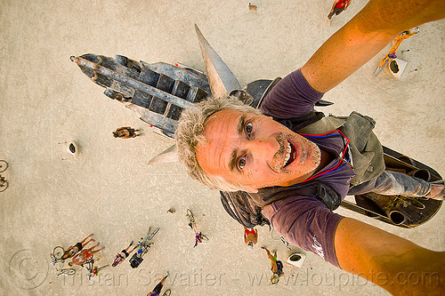 in the mouth of the coyote - burning man 2013, art installation, bryan tedrick, burning man, climbers, climbing, coyote sculpture, metal sculpture, self-portrait, selfie, statue, tristan savatier