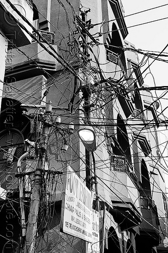 indian electric wiring on street poles, electric, electricity, foot fashion, india, lucknow, poles, sign, street light, tangled, wires, wiring